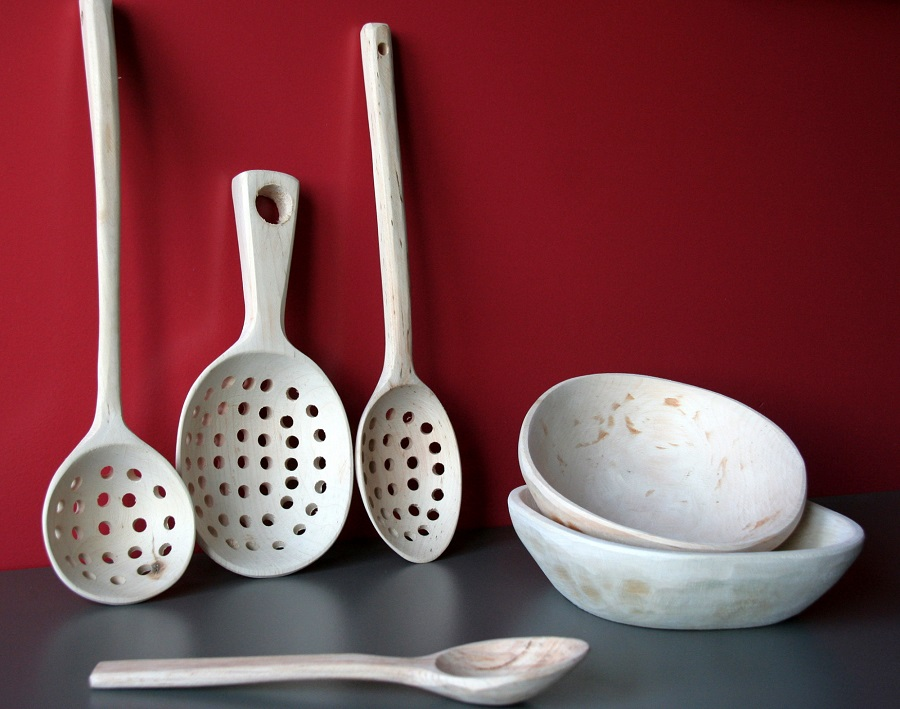 handicraft store - aset of wooden bowls, spoons, ladles, colanders, made with the traditional