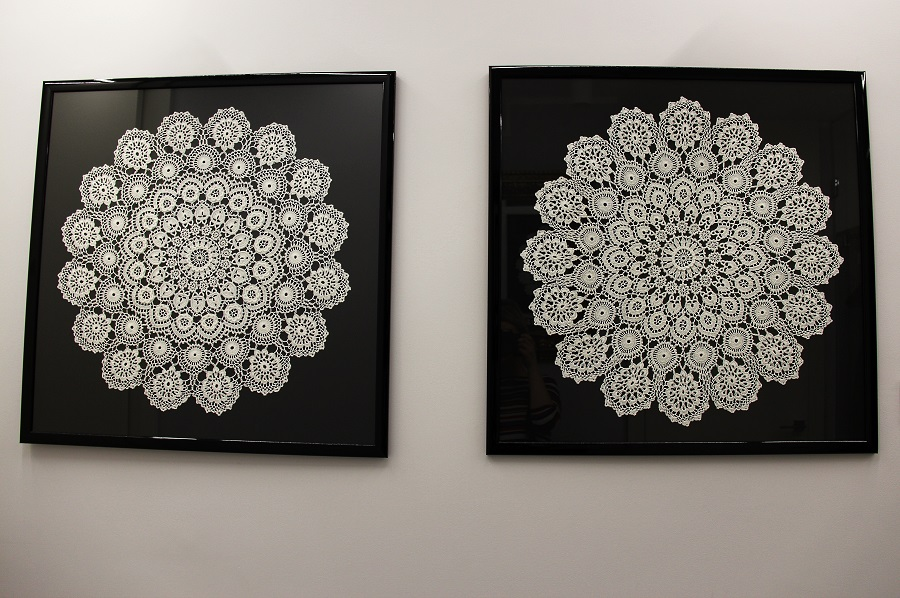 lace from Koniakow - two framed laces side by side in a modern hall