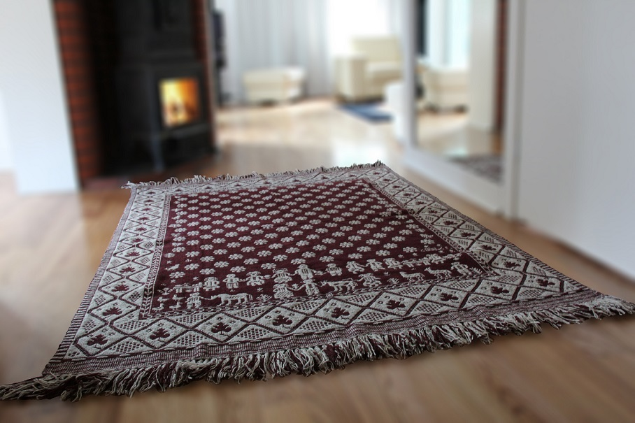 decorative fabric - acarpet in front of the fireplace