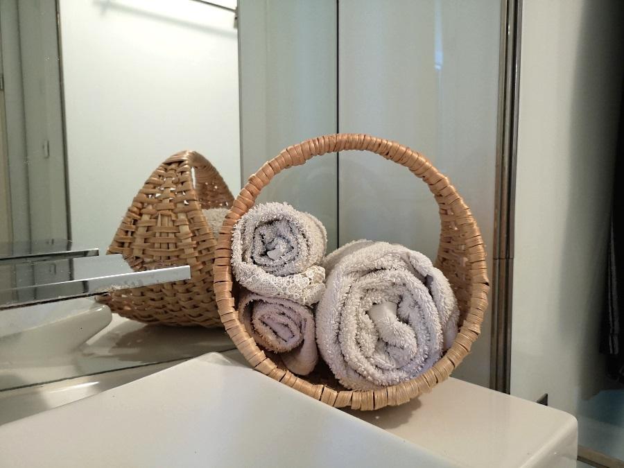 basket - cradle - wickerworks made of apine root - in amodern bathroom
