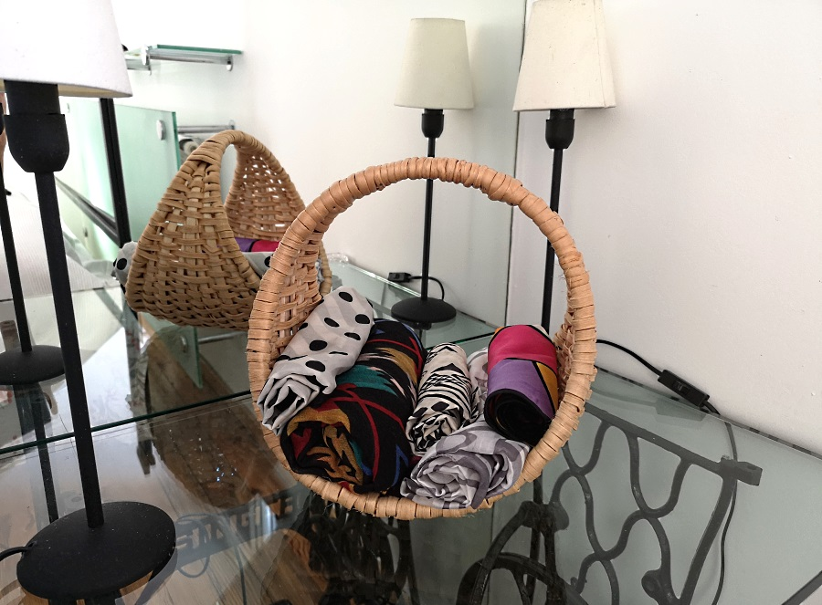 wickerworks made of apine root - basket with scarves in the hallway