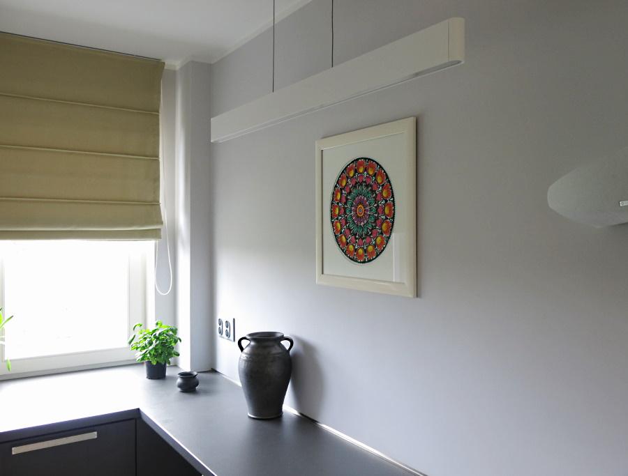 Lowicz paper cutout and folc ceramics (grey pottery) as adecoration of amodern kitchen
